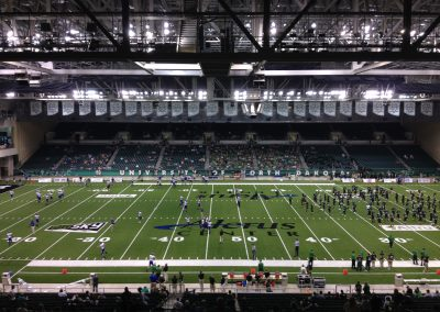 Alerus Center, the teams warm up before the game