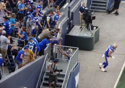 Investors Group Field, Winnipeg Blue Bombers Celebrating with Fans
