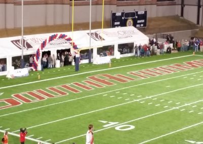 School Logos in the End Zones at the Cramton Bowl for the Camellia Bowl