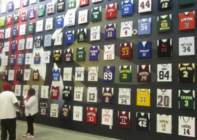 Smoothie King Center, wall of jerseys from local high school teams