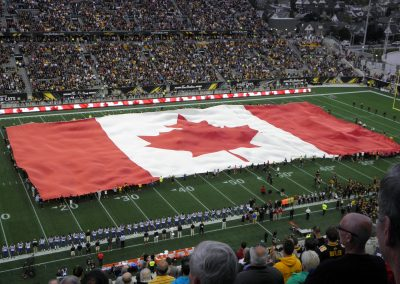 Tim Hortons Field, fans roll out the flag for the National Anthem
