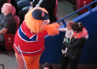 Youppi Interacts with a Young Fan