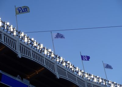 Flags Fly above Yankee Stadium during the Pinstripe Bowl