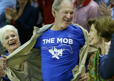 Former President George W. Bush suprises the crowd with The Mob shirt (SMU's student section) Credit USA Today
