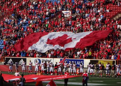 McMahon Stadium, fans waving the giant Canadian flag