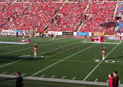 McMahon Stadium, Calgary Stampeders cheerleaders celebrating Canada Day
