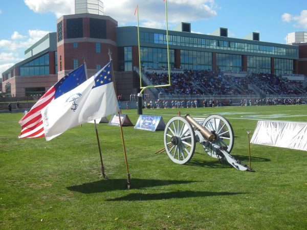 Meade Stadium, ROTC artillery piece with flags