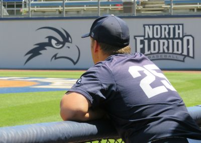 Coach Watches from Dugout