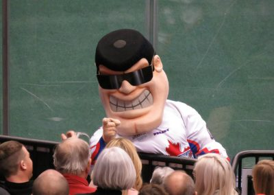 Rock Mascot Interacts with Fans
