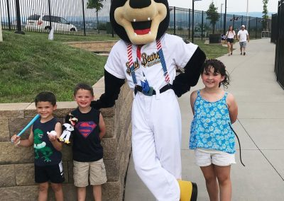 Cooper Poses with some Young Fans